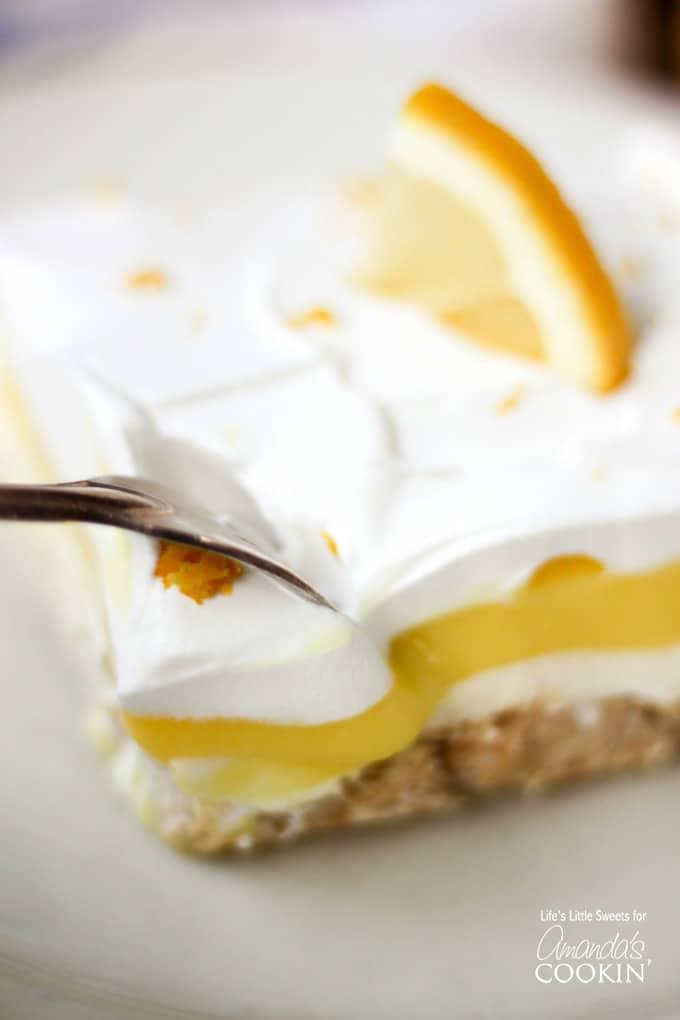 Dive in to your new favorite lemon one-pan dessert, Lemon Lush!!