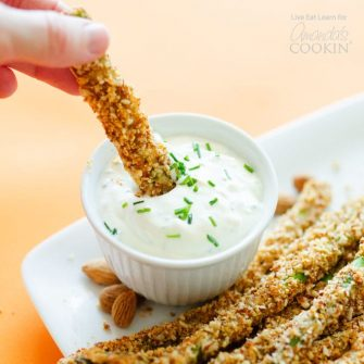 These asparagus fries are breaded with parmesan-y almond crumbs and baked for a few minutes to make crispy on the outside, tender on the inside veggie fries!