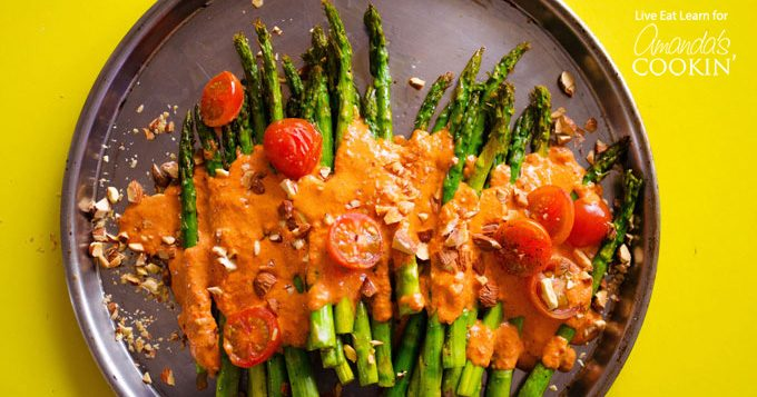 This Roasted Asparagus side dish is covered in delicious and healthy Smoky Romesco Sauce, cherry tomatoes, and crunchy chopped almonds. So good!