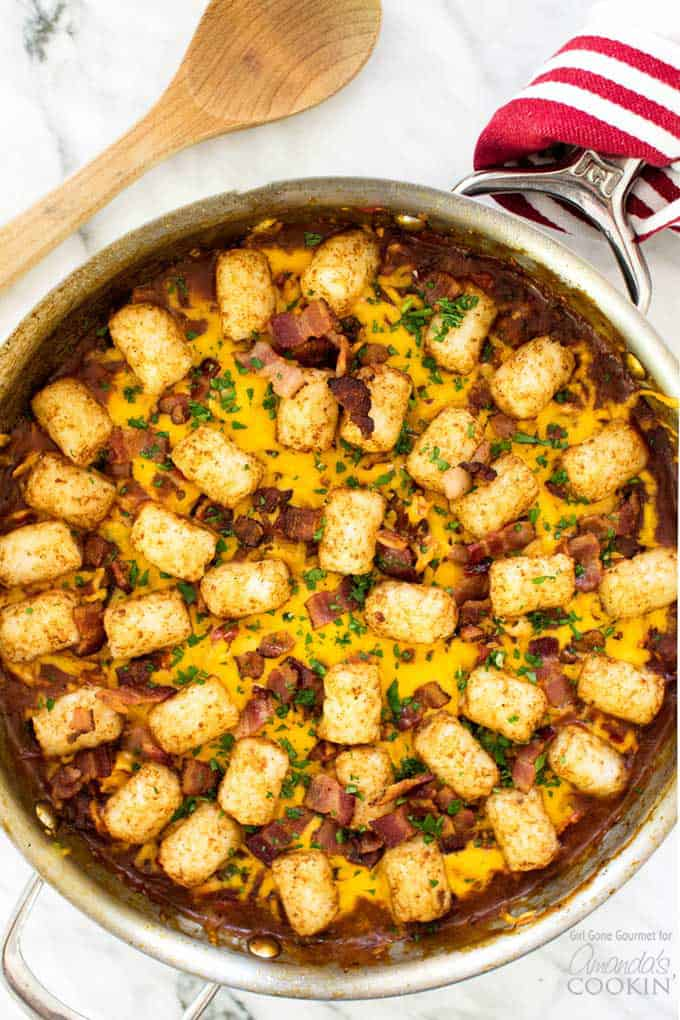 All the favorites are in this BBQ chicken tater tot skillet - toasty tater tots, crispy bacon, melted cheddar cheese, and shredded BBQ chicken.