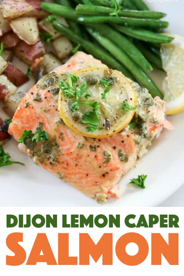 Dijon Lemon Caper Salmon with green beans and red potatoes topped with lemon
