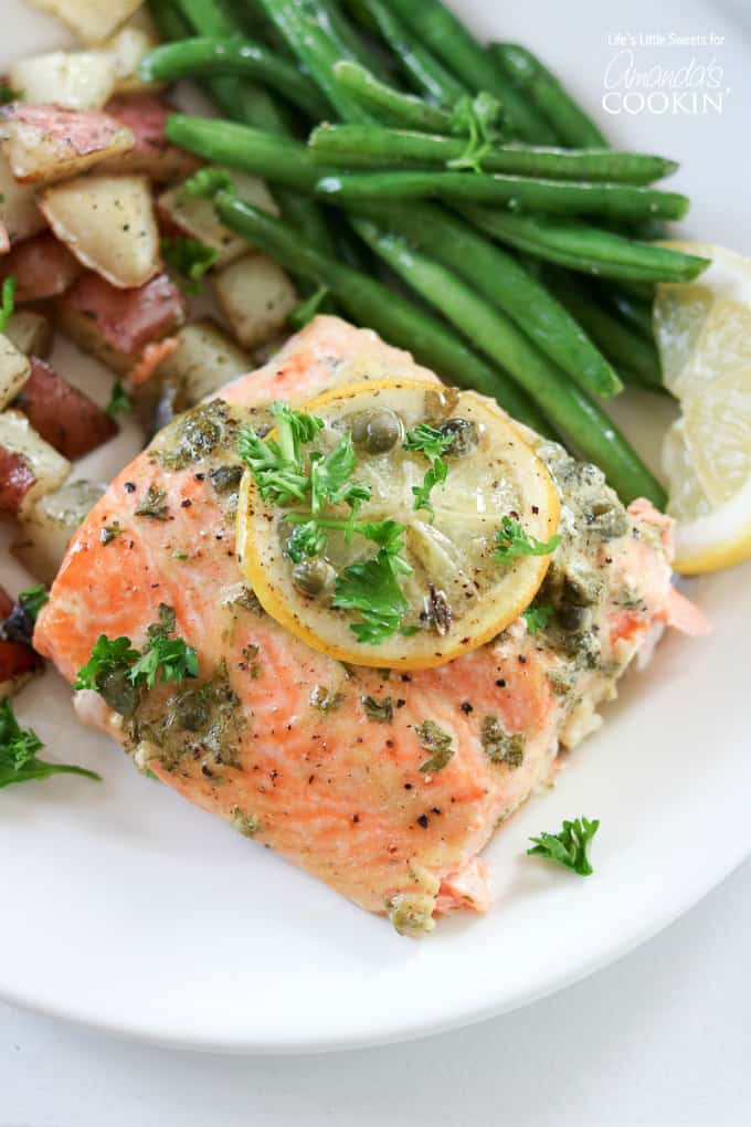 Red potatoes, green beans and dijon caper salmon served on a plate