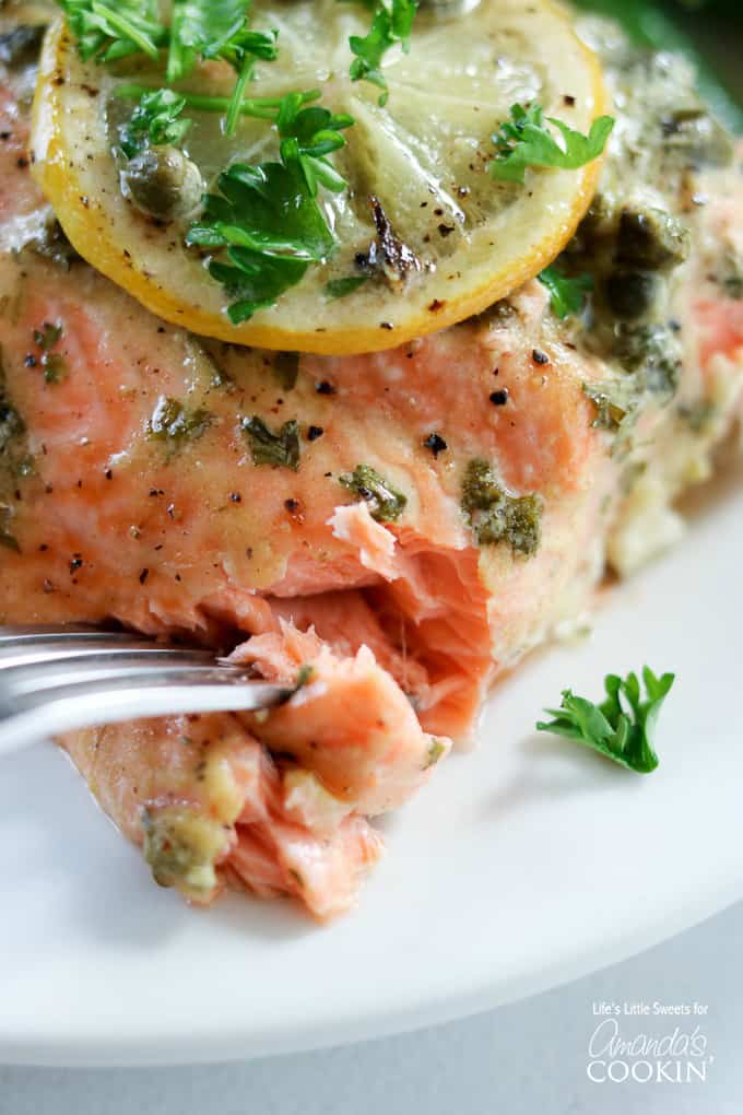 Flaky and satisfying dijon lemon caper salmon recipe.