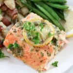 A close up of a salmon on plate