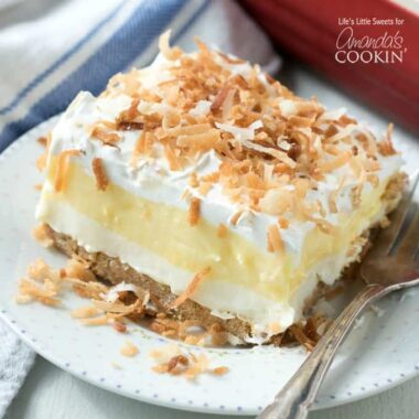 coconut cream pie layered dessert on a plate