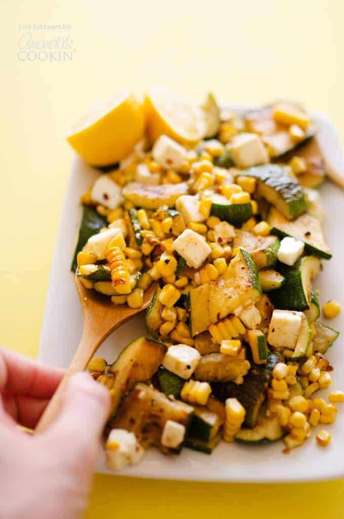 spoon of corn zucchini salad