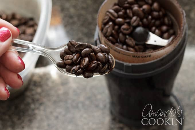 coffee beans into grinder
