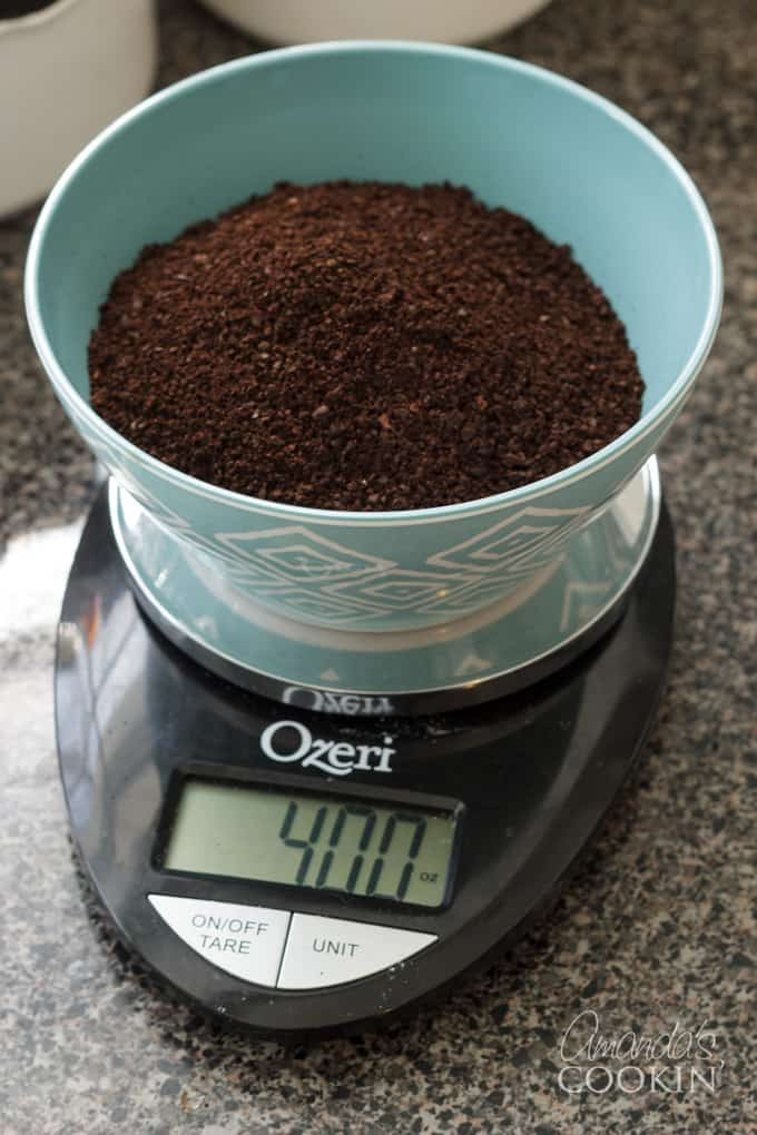 Grind enough coffee to measure 4-ounces, I use a simple kitchen scale.