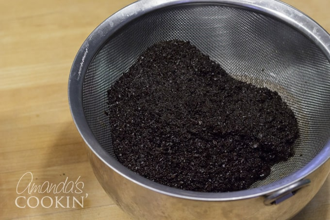 Discard or compost the coffee grounds.