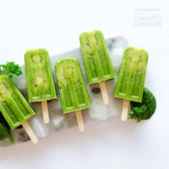 green popsicles on a plate of ice