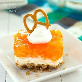 This one-pan Mandarin Orange Pretzel Salad boasts three layers of pretzels, cream cheese, and jello to make up this potluck favorite!