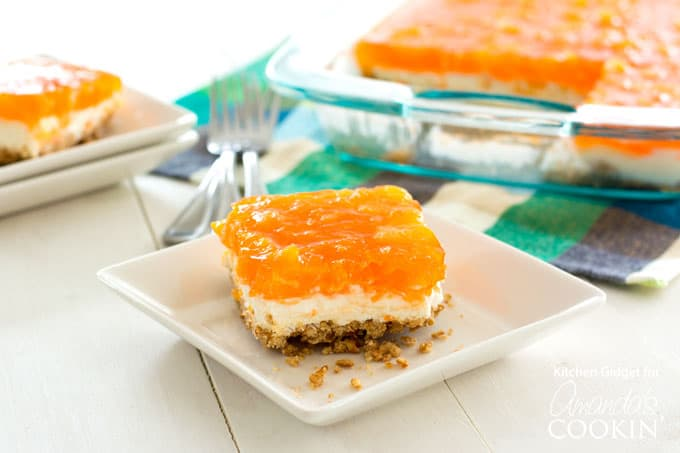 Indulge your guests with this Mandarin Orange Pretzel Salad dessert!