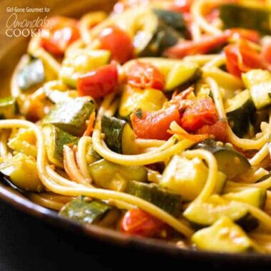 close up of zucchini tomato pasta in a bowl