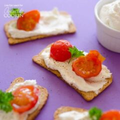 feta on crackers with cherry tomatoes