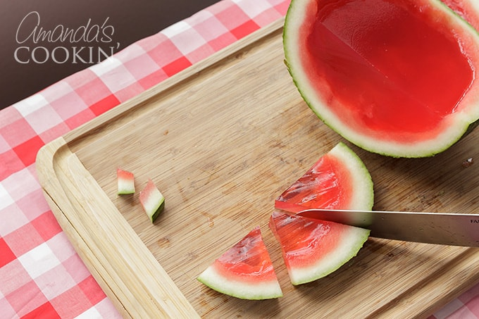 slicing watermelon jello shots