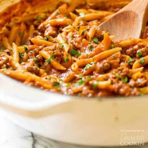 pan of sloppy joe pasta with a wooden spoon