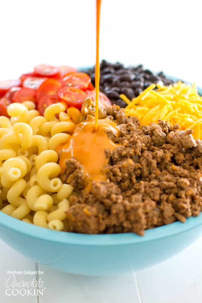 Colorful ingredients make up a tasty taco pasta salad.
