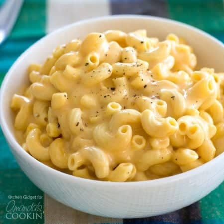 This creamy crockpot macaroni starts with uncooked macaroni. Just throw the milk, cheese, and seasonings in the slow cooker for a meal everyone will love!