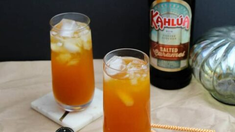 two tall cocktails with Kahlua in background
