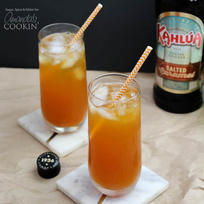 Caramel pumpkin cocktails with straws and salted caramel kahlua