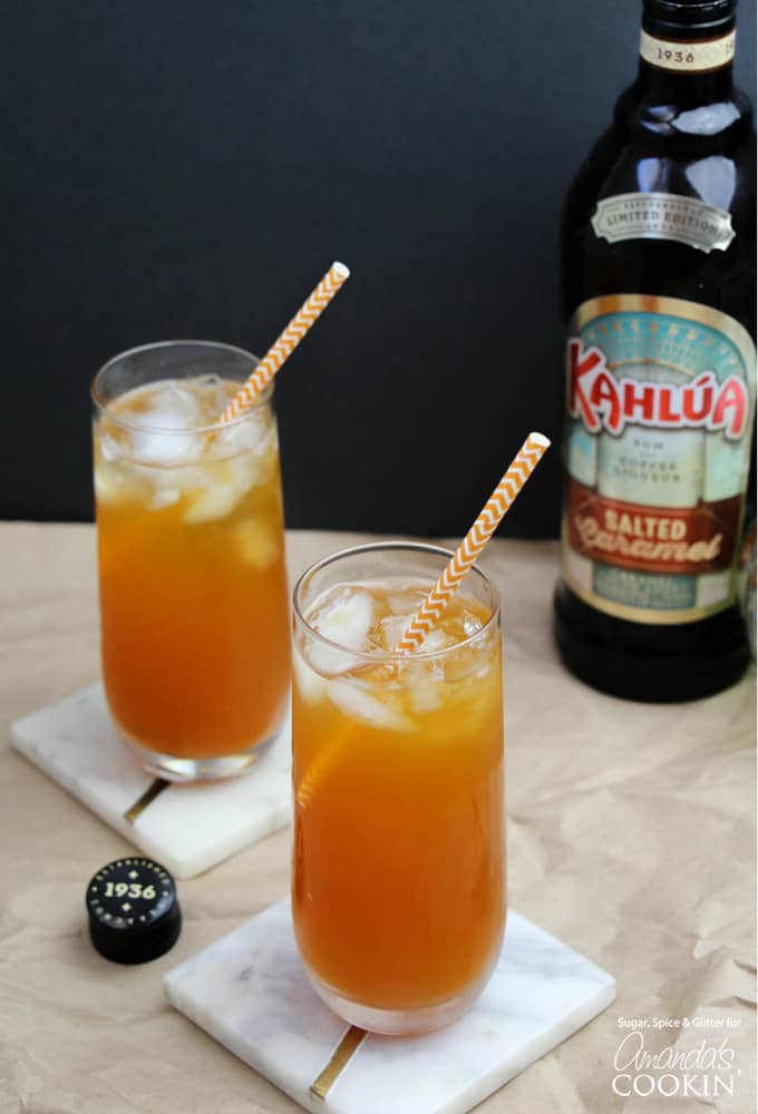 Caramel Pumpkin Cocktails in glasses with striped straws and Kahlua