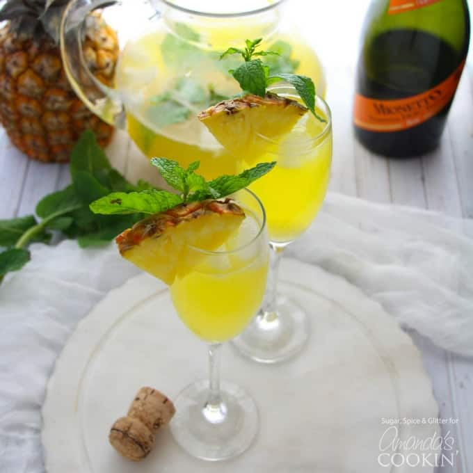This Pineapple Prosecco Punch is bursting with pineapple, white rum, mango juice, Prosecco and a hint of mint. Perfect for sipping and relaxing!