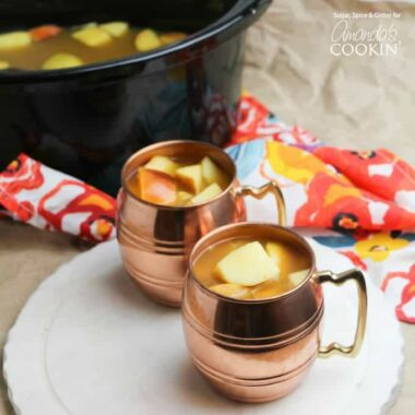 This Crockpot Caramel Apple Cider is the perfect warm drink to serve to a crowd this fall - and with no caffeine, kids can enjoy this delicious treat, too!