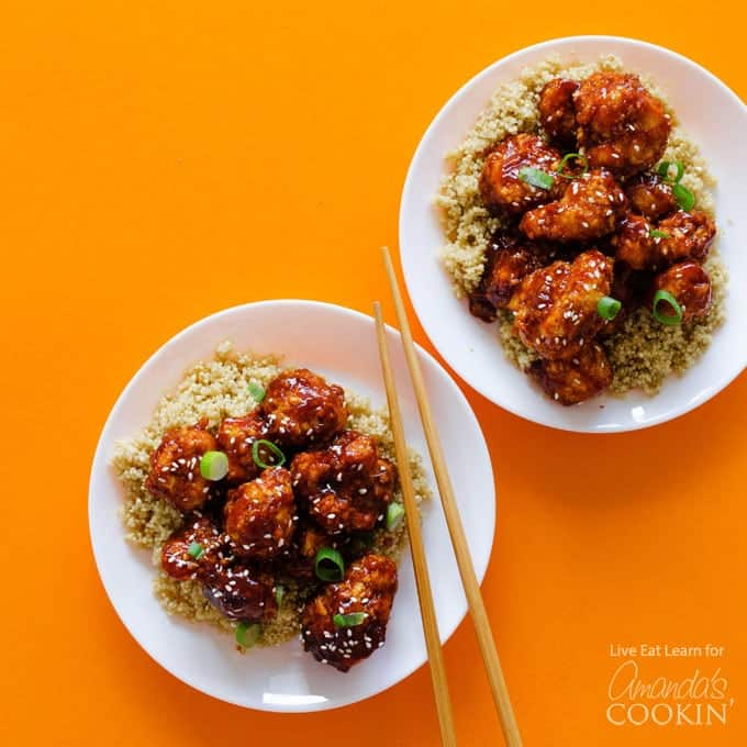 General Tso's Cauliflower on a plate with chopsticks