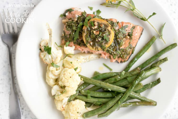 Sheet pan salmon dinner on a plate