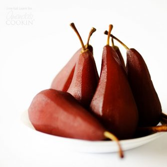 Stewed Pears: Soaked in red wine and spiced with the flavors of Christmas, they like to make a big batch of these and set them on the table whenever!