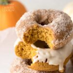 stack of pumpkin donuts with bite out of it