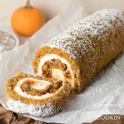 This Pumpkin Roll is a thin, moist pumpkin cake with or without walnuts, filled with a creamy frosting mixture and wrapped into a swirl of sweet heaven!