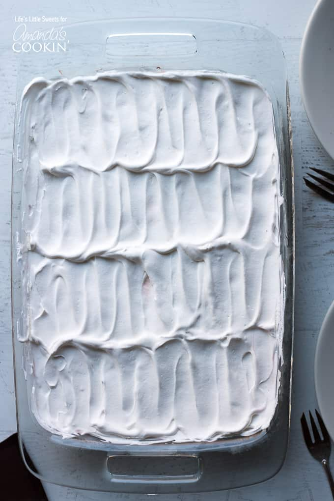 Red Velvet Lasagna Dessert in pan with whipped topping