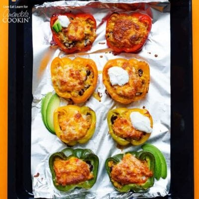 These Enchilada Stuffed Peppers are stuffed with spiced quinoa, beans, corn, and shredded Monterey jack cheese then drizzled with a simple homemade enchilada sauce and loaded with even MORE cheese.