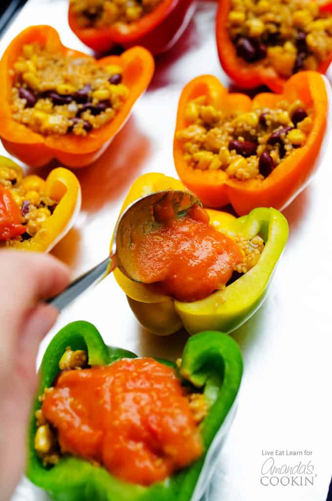 Adding sauce to enchilada stuffed peppers