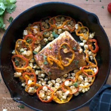cast iron pan with cod and vegetables