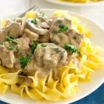 This classic beef stroganoff recipe from scratch features tender slices of steak and savory mushrooms smothered in creamy brown gravy. Serve over egg noodles for a satisfying dinner that's ready in less than 30 minutes!