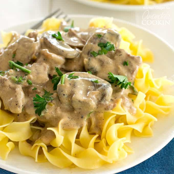 slices of steak and mushrooms in creamy brown gravy, over egg noodles