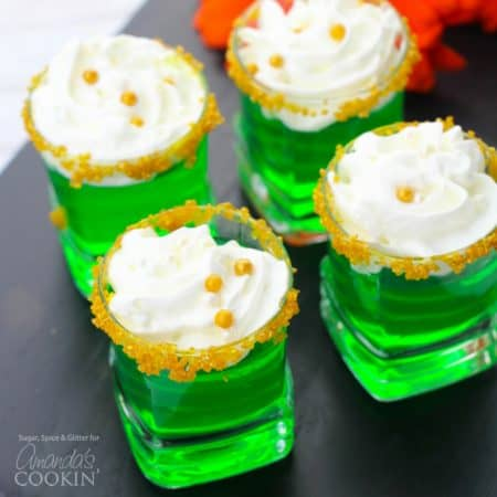 These Green Jello Shots with gold sugar rims and a dollop of whipped cream are perfect for St. Patrick's Day but are good for all summer long, too!