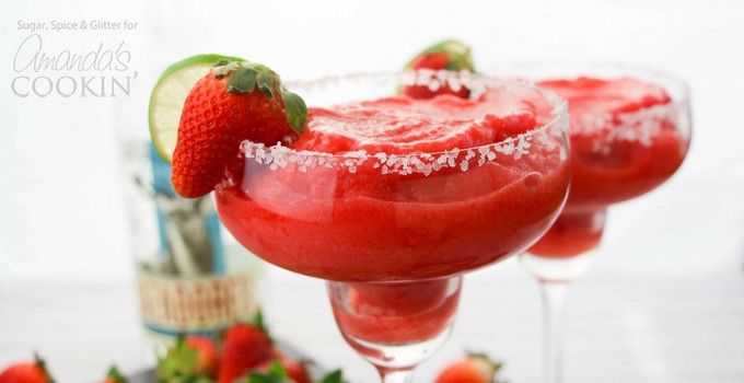 Strawberry Margarita with strawberry and lime garnish