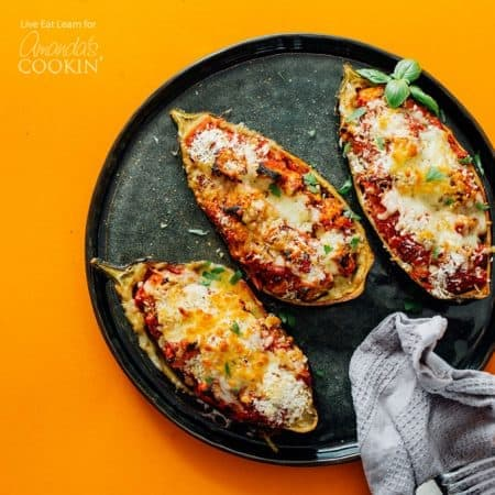 This fun take on Eggplant Parmesan takes all the deliciousness of this classic recipe and stuffs it into the eggplant skin, making it a fun recipe that's low on clean up!