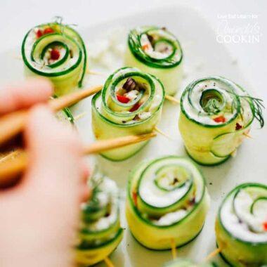 picking up cucumber sushi with chopsticks