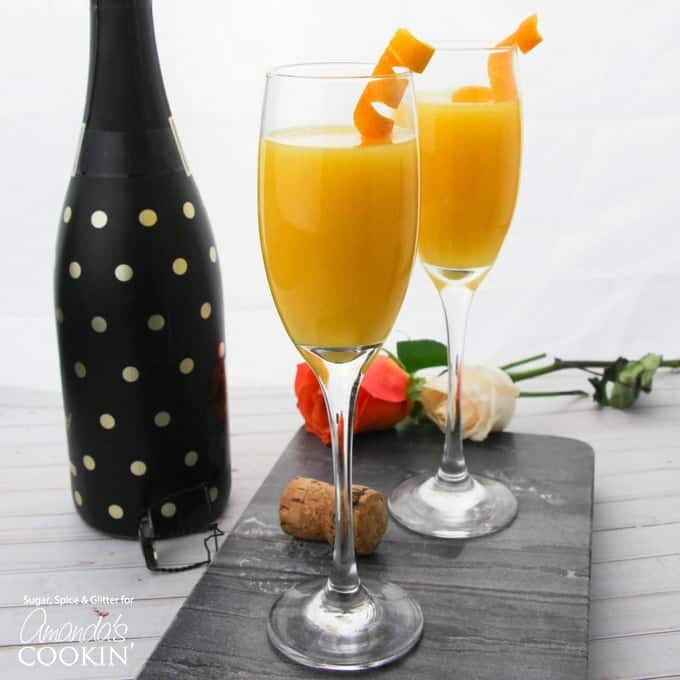 Mimosas with orange twist garnish