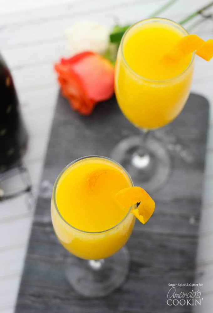 Mimosas overhead shot with orange rind twist