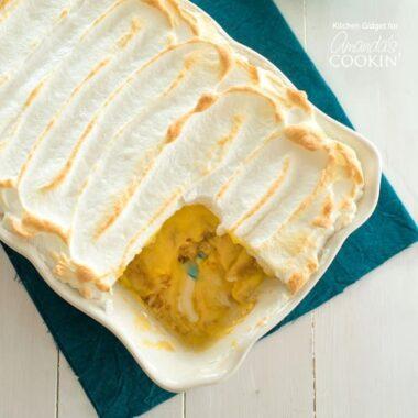 a pan of banana pudding with meringue topping