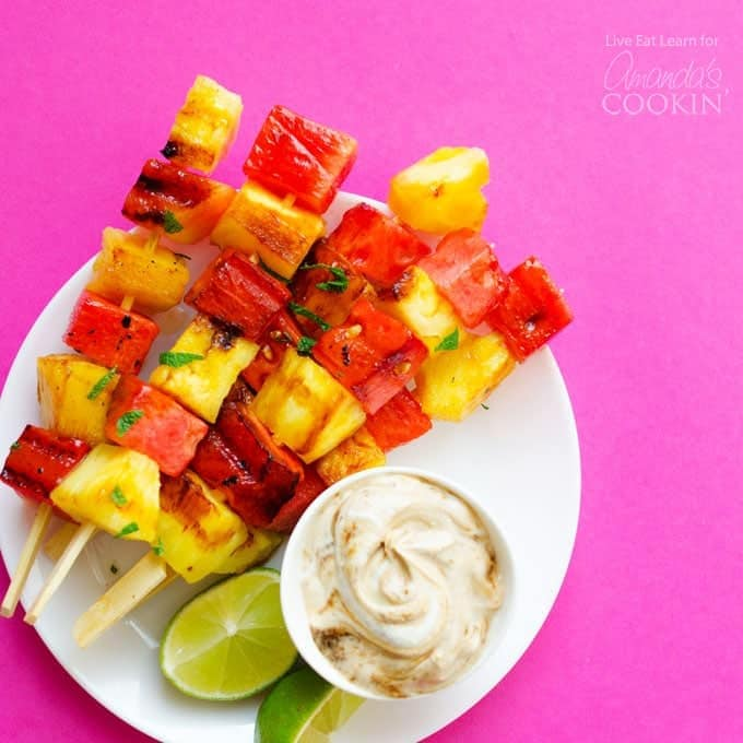watermelon and pineapple grilled and put on skewers served with yogurt sauce