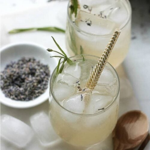 overhead view of lavender lemonade with gold straws