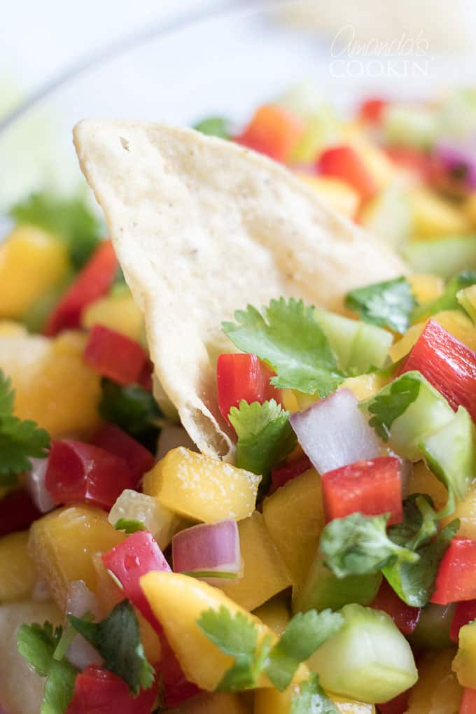 Close up of mango salsa and chips
