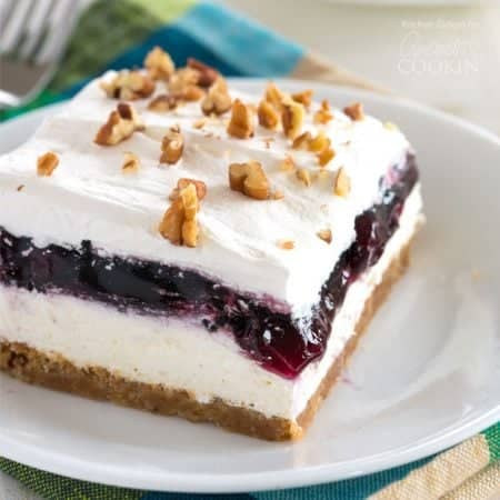 Blueberry Lush – a (nearly) no-bake blueberry layered dessert sure to delight everyone who tries it! Blueberry cheesecake meets blueberry fluff in this light one-pan dessert with a graham cracker pecan crust.