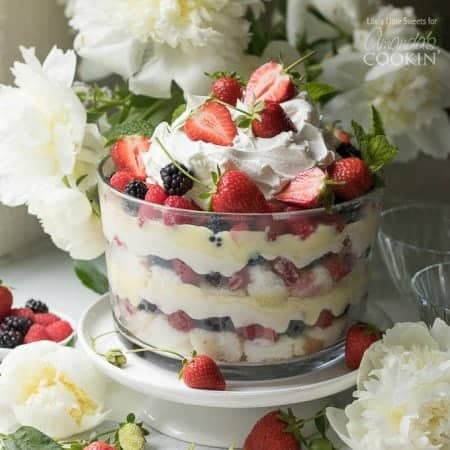This mixed summer berry triflerecipe is a delightfully delicious no-bake dessert, perfect for warm weather events or Fourth of July. It has two layers of angel food cake, sweet vanilla-lemon cream cheese, vanilla pudding, mixed berries and topped with cool whip and more mixed berries.